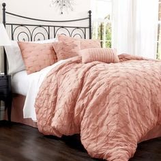 Offering romantic style for your master suite, this feminine comforter set showcases a lovely embroidered motif in peach.  Product: ...