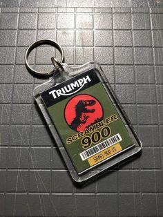 Jurassic World Triumph Scrambler 900 Keychain Jurassic Park Jeep, Jurassic Park World, Lightning Bug Crafts, M Class, Triumph Scrambler, Acrylic Photo, Dinosaurs, Keychains, Prints