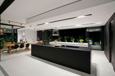 A Black & White Minimal Home In Australia: Doonan Glass House by Sarah Waller Design