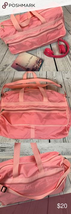 """🆕 American Tourister PINK Travel Tote Gym Bag ❤ Beautiful bag!!! Great for Valentines Day!! I looooove the POSH PINK!! Shoulder strap with a million zippered compartments (ok not a million but a lot LOL). In very good condition appears to not have been used smoke free home! Perfect new bag to rock your workout OR your flight!! Larger size. Measures approximately 19"""" across (with room to bump out) by 15"""" tall (actual bag) and 7"""" Wide at bottom. Adjustable shoulder strap to make a cross body…"""