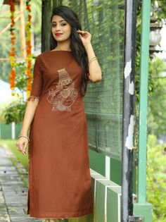 Kanha - Trendy and traditional! coffee brown handloom straight cut kurti enhanced with kadhakali motif gold thread embroidery on chest and thread fringes on sleeves.