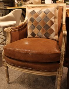 What a neat & #unique #leather #chair and #hair on #hide #pillow! Stop by #WHLuxe, take a seat & own it today! #InteriorDesign #LuxuryFurniture #Furniture #HomeDecor #Decor #LuxuryLiving #LuxuryLifestyle #UniqueFurniture #UniquePillow #HomeFurnishings #HancockAndMoore  For more information please visit www.WHLuxe.com