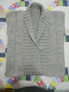 Just finished Eco Vest (hasn't been blocked yet) in 100% wool. Free pattern at Knitting Daily.