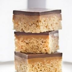 Chocolate, Caramel, Peanut Butter Rice Krispie Bars 3	tablespoons butter 10-ounce bag marshmallows or mini-marshmallows 1	tablespoon vanilla 7	cups Rice Krispies cereal 14-ounce bag unwrapped caramels 2	tablespoons water 1½	cups peanut butter, divided use 12-ounce bag semisweet or dark chocolate