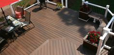 Pro-Tect Decking in Chestnut, Horizon Railing Mission White with Round Metal Black Balusters