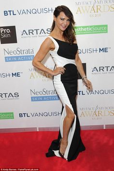 Monochrome madness: Party-circuit regular Lizzy Cundy looked stunning in a black and white...