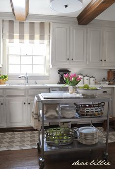 Love the stainless steel kitchen island in this home tour of Dear Lillie featured at eclecticallyvintage.com