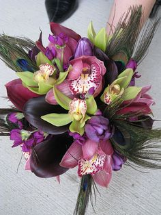 purple, orchids and peacock feathers - I heart this bouquet
