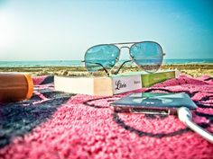 sunglasses. beach. ipod. book