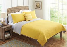 In store special for a limited time! Get this vibrant yellow comforter set for just $49.96 – any size!