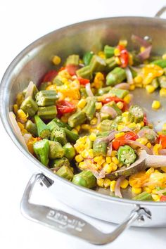 Okra Succotash, a simple sauté of fresh okra, corn, tomatoes, and onions, is a yummmmm side dish for your next cookout... just in time for Memorial Day! I love this side because it's fresh and filled with seasonal veggies that will make you feel good on a hot sunny day.