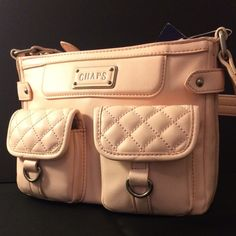 NWT Chaps quilted cross body  Beautiful soft rose colored, quilted pockets, soft leather, zipper middle pocket with interior pockets, cell phone pocket, back zipper pocket, and adjustable strap.  Very nice bag!  Chaps Bags Crossbody Bags