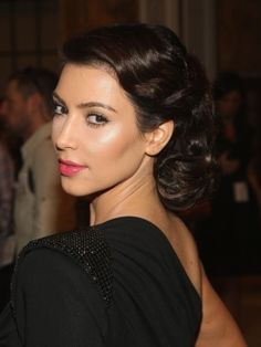 My wedding hair via Kim Kardashian Vintage Updo--the ladies at Michael Christopher's hooked me up perfectly that day.