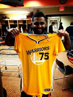 It's good to see the Giants supporting our Bay Area teams.  You've seen a number of Giants sporting 49ers caps during their Super Bowl run, and here, PABLO SANDOVAL proudly displays his personalized short-sleeve Golden State Warriors jersey. Go Dubs!