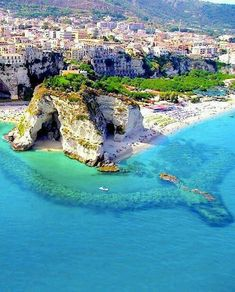 Calabria, Italy. My favorite part about this picture is how clear the sea is, so clear that you can see the bottom. It seems like a fantastic place to be, especially the town further back.
