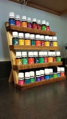 Essential oils rack for 5ml and 15ml bottles. Custom made from JK Forever Woodworking www.facebook.com/jkforeverwoodworking