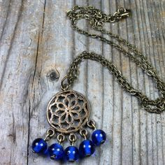 Singing the Blues Necklace  antique brass / gold chandelier pendant / charm by MySoulCanDance