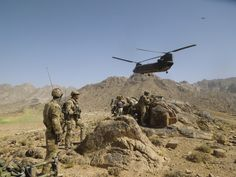 A U.S. Army helicopter overflies Australian Special Operations Task Group and Afghan National Security Force elements during a cordon and search mission in Kandahar province, southern Afghanistan.