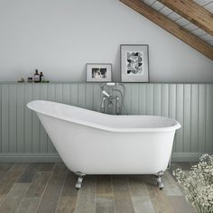 The stunning Ashton 1530 x 760mm Slipper Roll Top Cast Iron Bath with Chrome Feet. A perfect centrepiece for traditional settings. In stock online now.