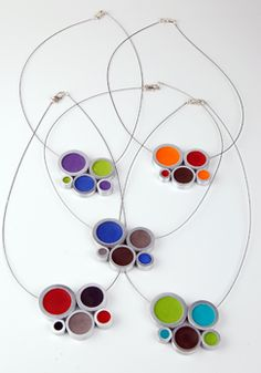 Cluster Necklace, available in a variety of color combinations, by Stubborn. Stubborn offers signature modern design jewelry made from industrial metals filled with certified green resin. American Made. 2013 Buyers Market of American Craft. americanmadeshow.com