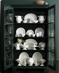 Love the contrast of white dishes and dark hutch