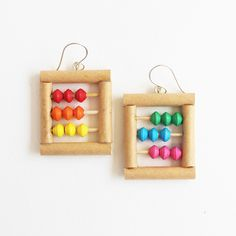 These abacus earrings are composed of little paper beads I meticulously handcrafted from upcycled paper in vibrant colors. The beads are free to move about in their wooden rods, just like a real abacus! Funky Earrings, Funky Jewelry, Geek Jewelry, Unique Earrings, Diy Jewelry, Jewellery, Unique Jewelry, Teacher Gifts, Math Teacher