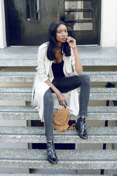 Natasha Ndlovu is wearing high waisted denim jeggings from Asos and a pair of black leather ankle boots from Jimmy Choo