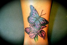 Purple iris tattoo with buterfly