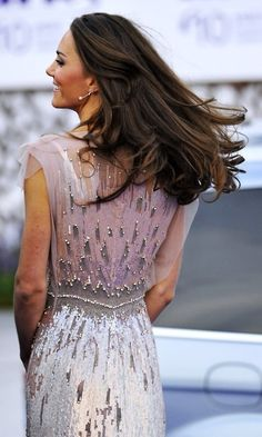 Beautiful Princess Kate with her long brown hair flowing in the wind~ Beautiful dress too!