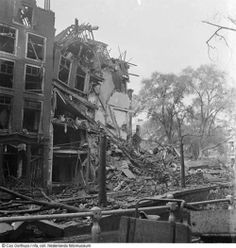 5-11-1940. Gebombardeerde panden hoek Blauwburgwal - Herengracht, Amsterdam (51 doden). #amsterdam #worldwar2 #Herengracht