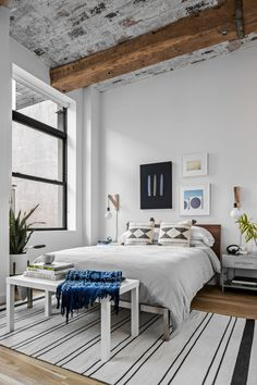 Bedroom with exposed beams in a New York bachelor pad