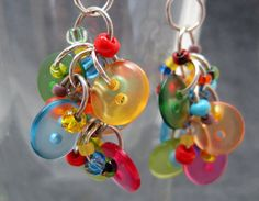 A button earring design from randomcreative!  I created these earrings with small two-hole buttons and seed beads in a wide mix of colors. I