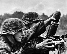 Soldiers of the SS division of Totenkopf are firing from 81-mm mortar