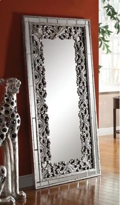 Mirror Glows with silver finish with black accents. Leans against the wall for a modern look. You'll love the instant elegance that this Vern accent mirror, a decorative piece, adds to your home.