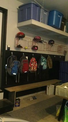 Organization for our garage. Used old metal freezer baskets for storage,wainscoting for accent and barn boards to make bench