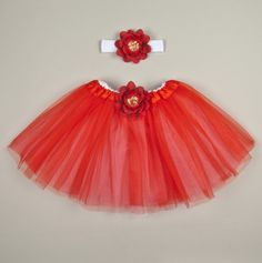 Red And White Tutu With Couture Red Sequin Centered Flower And Matching Headband for Little Girls.