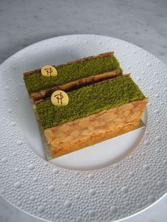 Hermes - IBIZA: Biscuit Dax Pistachio Joconde biscuit, mascarpone cream with orange mousse nougat, crunchy almond nougat.