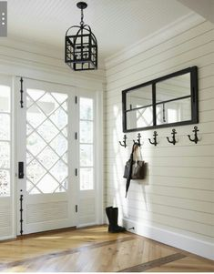 Front door glass design- love the diagonal/diamonds. Gorgeous wood inlay flooring and plank walls; contrasting mirror, anchor hooks and pendant lamp / Muskoka Living Design Entrée, Design Case, Interior Design, Interior Colors, Design Hotel, Interior Walls, Bathroom Interior, Interior Ideas, Design Ideas