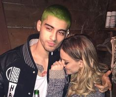 His fiancée Perrie Edwards shared the picture on her Instagram page, showing her giggling at the new look. | So, Zayn Malik Has Bright Green Hair Now