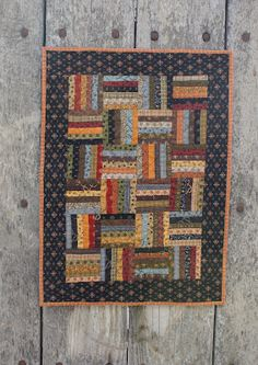 rail fence from Jo's little women club. Mine was made at TQC and hand quilted..love it!