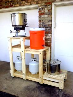 A 3-tier wooden brewing system.