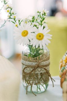Burlap, lace, daisies tied together with twine filled in mason jar #weddingcenterpieces #masonjar #cheapwedding