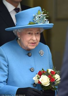 The Queen wore one of favourite bold blue coats and a hat topped with flowers as she arriv...