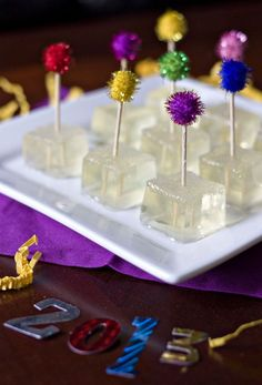 Champagne Jello Shots for New Year's Eve!! I've tried her Birthday Cake Jell-O shots and they were great - love the pompoms..
