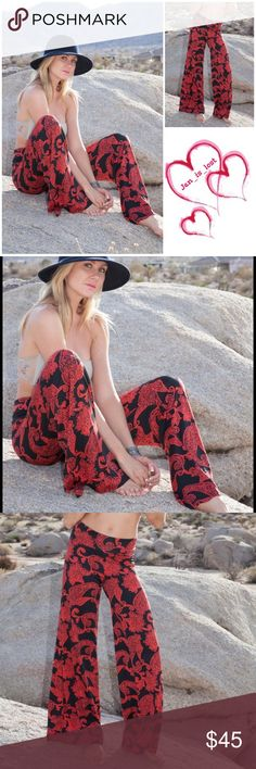 "Red & Black Palazzo Pants S, L Red and black Palazzo pants 95% Poly 5%Spandex  Small measures 13"" in the waist and stretches out to 15"" and 32"" inseam. Large measures 15"" in the waist & stretches out to 18"" and  32"" inseam. Pants"