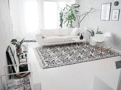 Large, black and white rug (200*290cm), hand-made, 100% wool. I like it, looks pretty nice in our living room even though it is very different.