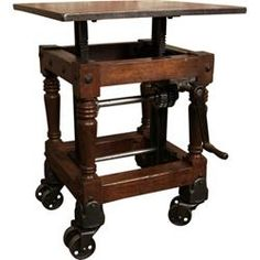 Original, Vintage Industrial, American Made, Adj. Crank Table with wood turned legs on a wooden frame with a metal top and cast iron fittings.