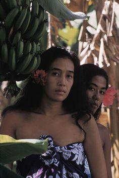 TAHITI. Two women in a banana grove whose faces resemble a Gauguin painting, photo Burt Glinn, 1960.