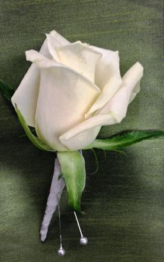 Ivory rose boutonniere with gray stem wrap for an Ombre' wedding. Colors included ivory, blush, light pink, medium pink, and hot pink! Boutonniere by Seasonal Celebrations.