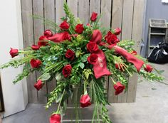 Red roses casket spray